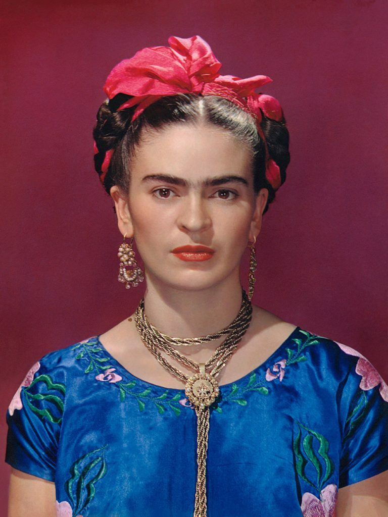 Nickolas Muray, Frida Kahlo in blue satin blouse (1939).