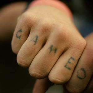 Game Over tattooed on a mans hands outside Tankerville Hotel VIP section commonly the area of the pub that caters for gamblers - Melbourne.