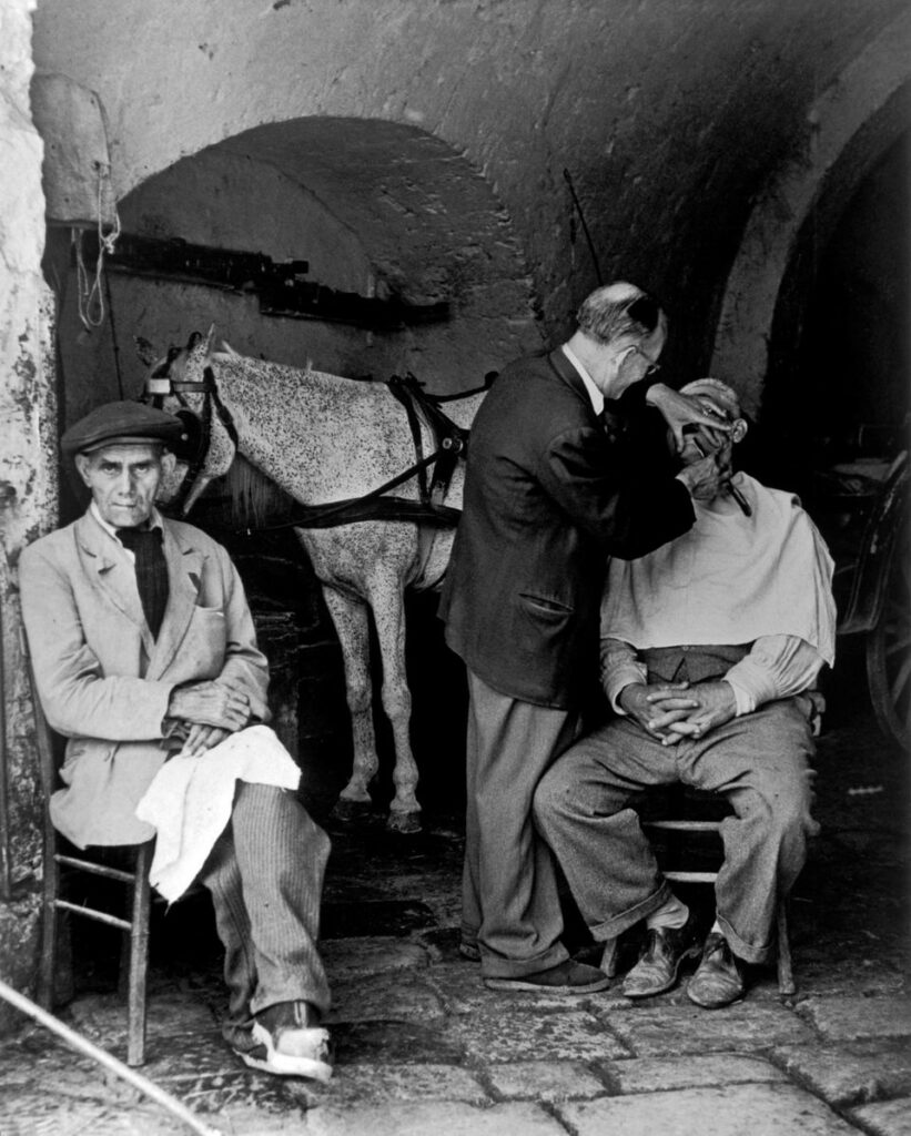 Herbert List, Shave at the stables, Naples, Italy, 1949