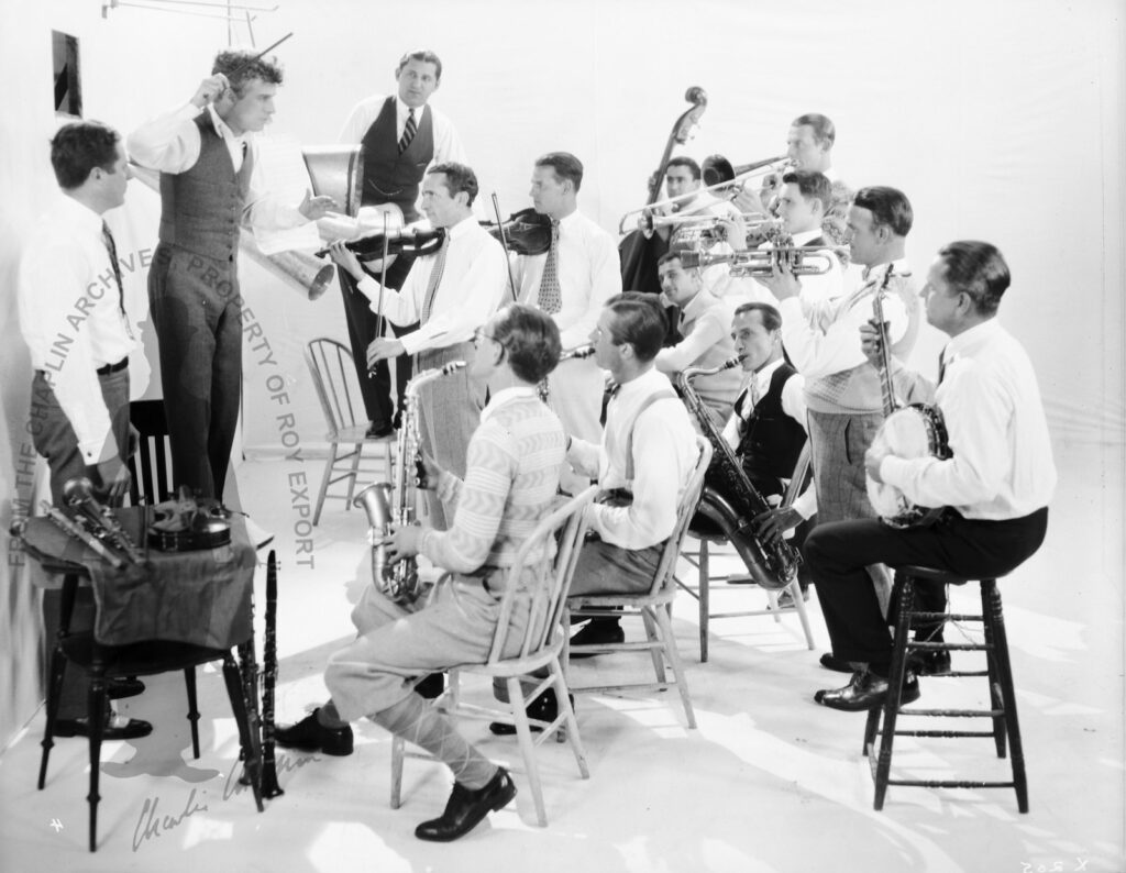 Charles Chaplin rehearsing with the Abe Lyman Orchestra, 1925