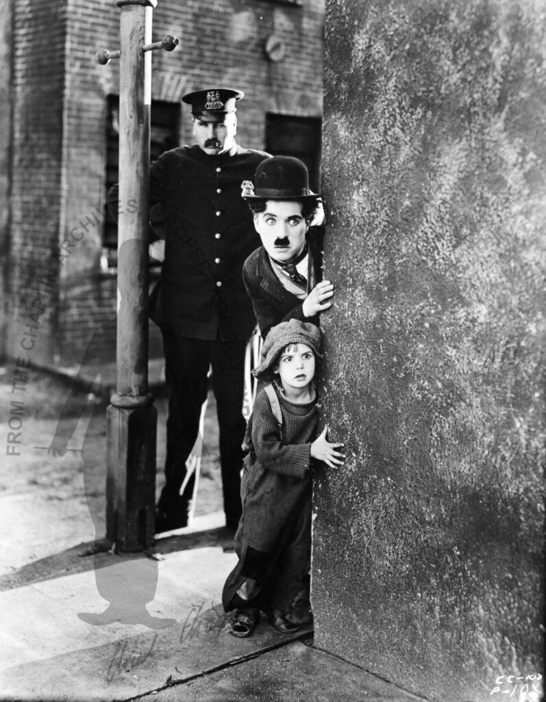Charlie and Jackie in the street, 1919