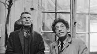 1961, Paris, France --- Irish writer Samuel Beckett, at the workshop of the Swiss sculptor and painter Alberto Giacometti (R), in rue des Archives, Paris. --- Image by © Georges Pierre/Sygma/Corbis