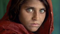 "CAPTION: Sharbat Gula, Afghan Girl. Peshawar, Pakistan, 1984.   MAX PRINT SIZE: 40x60'   Sharbat Gula, at Nasir Bagh refugee camp near Peshawar, Pakistan, 1984 -Untold (pg. 81)  National Geographic Magazine, Vol. 167, No. 6, June 1985, Along Afghanistan's War-torn Frontier.  ""The green-eyed Afghan girl became a symbol in the late twentieth century of strength in the face of hardship.  Her tattered robe and dirt-smudged face have summoned compassion from around the world;  and her beauty has been unforgettable.  The clear, strong green of her eyes encouraged a bridge between her world and the West.  And likely more than any other image, hers has served as an international emblem for the difficult era and a troubled nation."" - Phaidon 55  The iconic image does not stand outside of time.  Rather, it connects with the moment in a deeply profound way.  Such as images are imbued with meaning, a significance that resonates deeply with a wide and diverse audience.  McCurry's photograph of the Afghan girl is one such image.  For many, this beautiful girl dressed in a ragged robe became a worldwide symbol for a nation in a state of collapse.    Haunted eyes tell of an Afghan refugee's fears.   --  Bannon, Anthony. (2005). Steve McCurry. New York: Phaidon Press Inc., 12.  NYC5958, NN11480593, MCS1985002 K035  Afghan Girl: Found National Geographic, April 2002  Phaidon, Iconic Images, final book_iconic, page 33.  National Geographic Magazine, Along Afghanistan's War-torn Frontier, June 1985, Vol. 167, No. 6  Afghan girl, Pakistan, 1984 (Looking East, pg. 28)   South Southeast_Book In the Shadow of Mountains_Book Steve Mccurry_Book Looking East_Book Iconic_Book Untold_book PORTRAITS_APP final print_MACRO final print_Sao Paulo  final print_Milan  final print_Birmingham  Fine Art Print final print_HERMITAGE final print_Zurich final print_Ankara, Michener, Utica Graphic Novel_Book Retouched_ Eli Durst, Sonny Fabbri 03/30/2015"